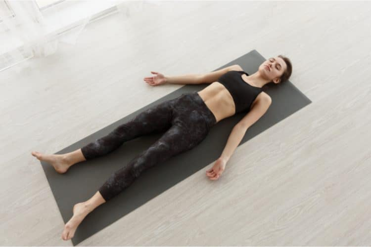 yoga routine on a yoga mat