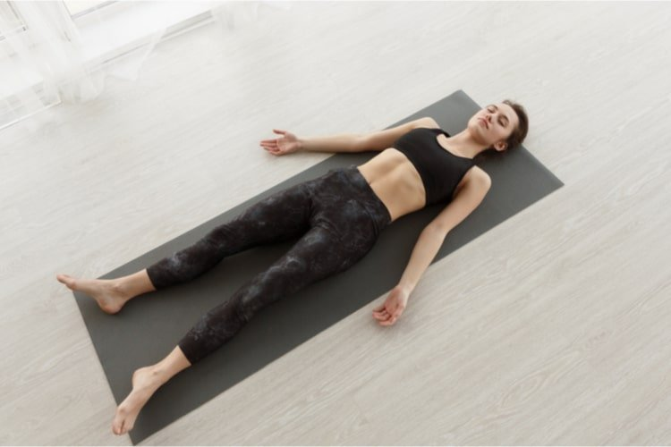 yoga routine on a yoga mat
