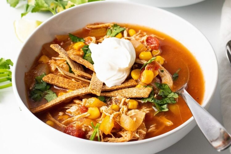 Our slow cooker chicken fajita tortilla soup is full of incredible Southwest flavors.