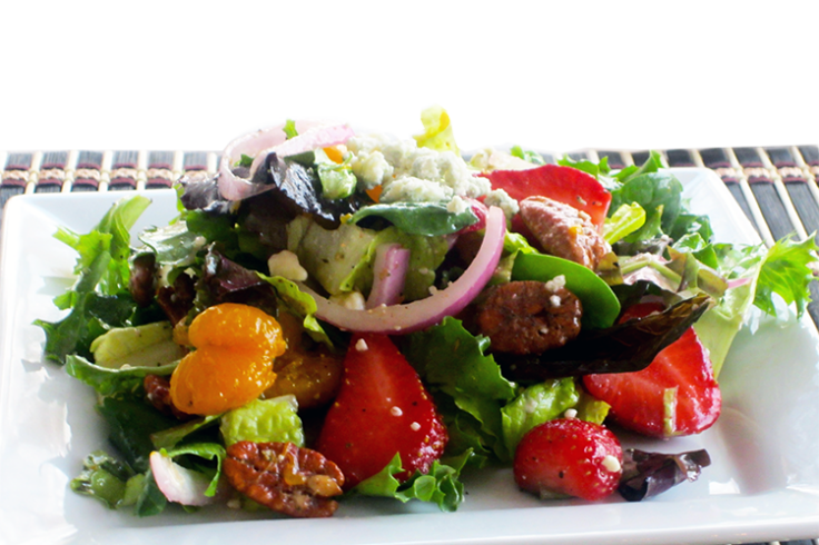summer salad with strawberries and candied pecans
