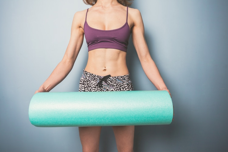 Use a foam roller at home to reduce muscle soreness and tightness.