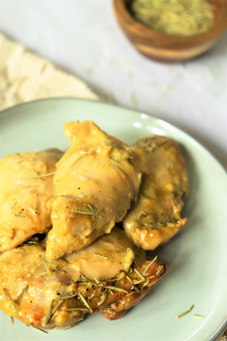 This slow cooker honey mustard chicken is tangy, sweet, and absolutely delightful!