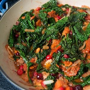 Wilted Greens with Cranberries & Tomatoes Thumbnail