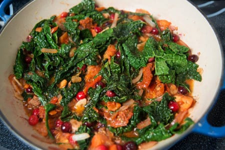 Wilted Greens with Cranberries & Tomatoes