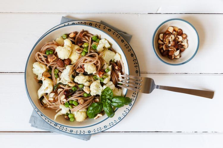 Spaghetti with Cauliflower, Peas, Hazelnuts, and Basil