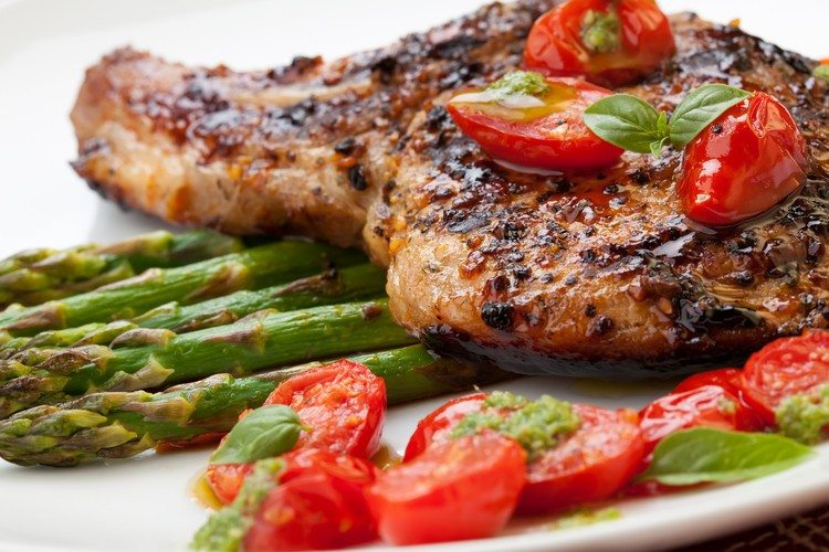 15 high protein low carb dinner recipes grilled pork chops with asparagus and pesto forumfinder Gallery