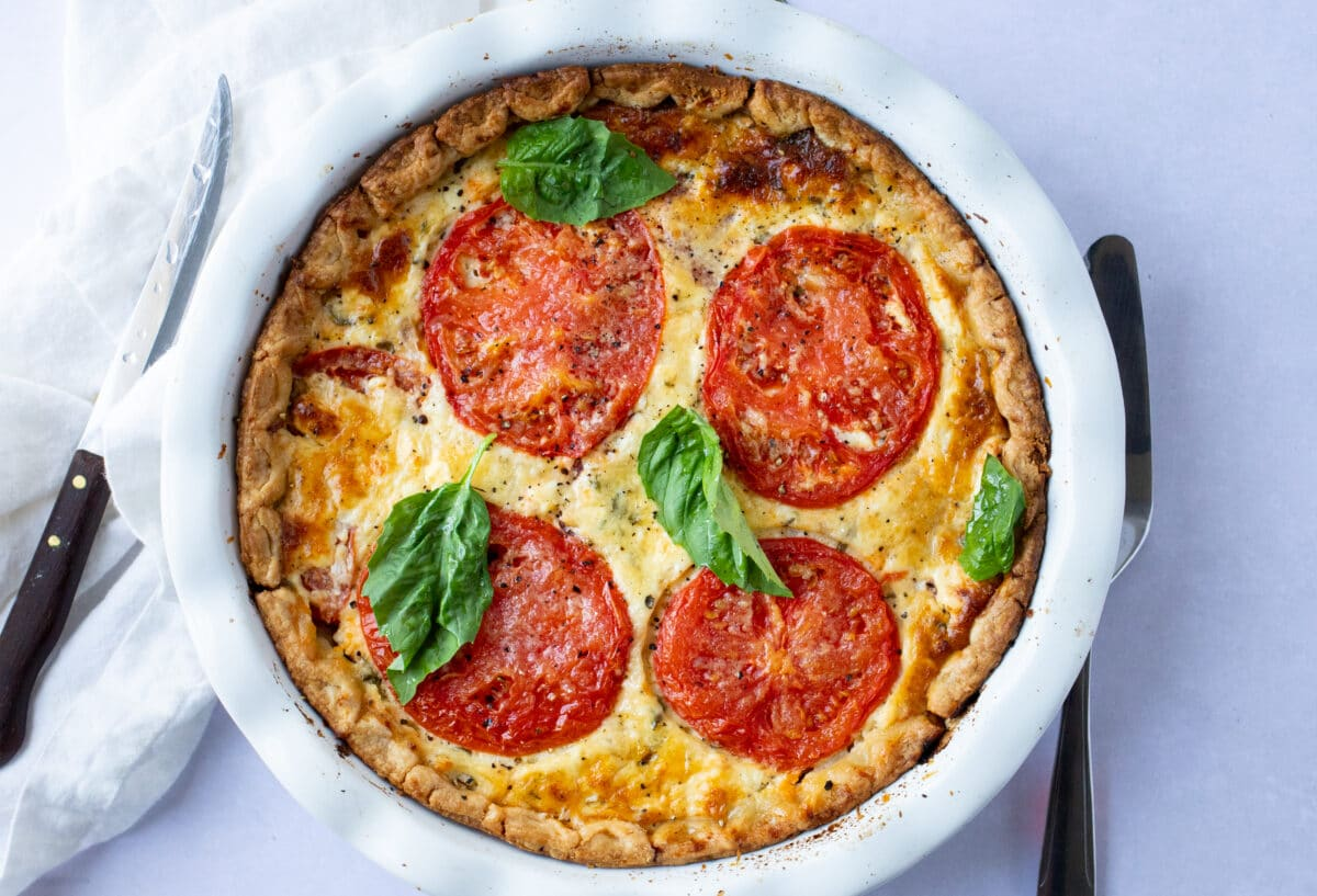 Our deep dish tomato pie is a wonderfully rich and flavorful southern dish!