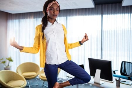 9 Yoga Poses You Can Do at Work