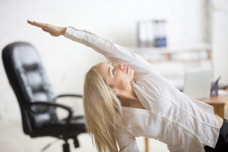7 Exercises You Can Do While Sitting At Your Desk