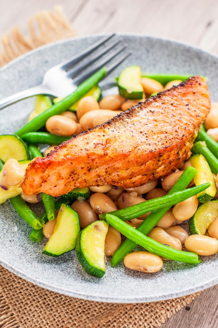This broiled lemon salmon over warm butter bean and green bean salad recipe is easy and mouthwatering!
