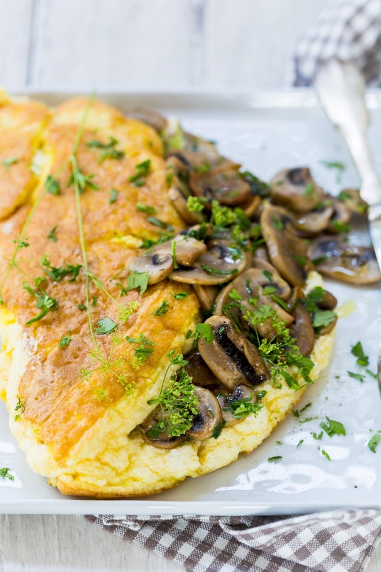 Don't be afraid to eat a dish like thisSoufflè Omelette with Mushrooms for lunch or dinner, though.Being composed primarily of eggs, this dish is very rich in protein while being naturally low in carbs and sugar.