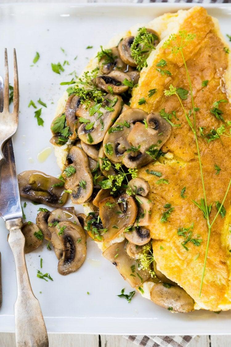 Imagine a big, hefty slice of a fluffy, soft omelette that's filled with sautèed mushrooms