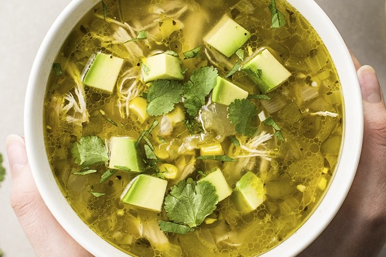 Our instant pot chicken posole verde recipe is rich and hearty in flavor, yet will leave you feeling light and satisfied!