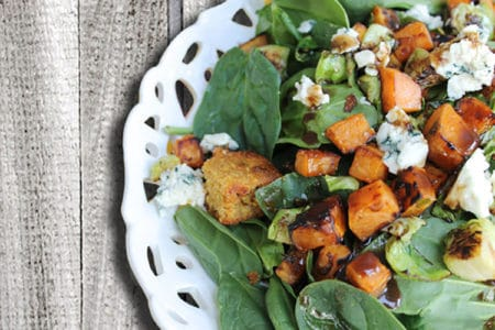 Spinach and Roasted Vegetable Salad with Cornbread Croutons and Maple Vinaigrette