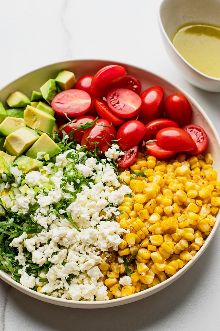 Elote Tomato Avocado Salad blends roasted corn, minus the cob, with the right amount of spices and textures