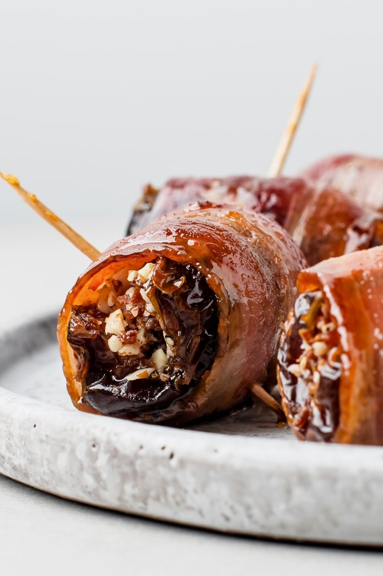 These sausage stuffed dates with bacon are meat candy!