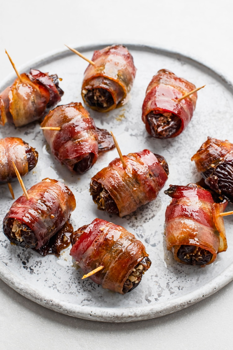 These delicious sausage stuffed dates with bacon are rich and a crowd pleaser!