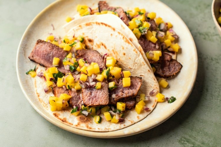 These Grilled Tuna Tacos with Fresh Mango Pineapple Slaw are the perfect Summer time dinner recipe!