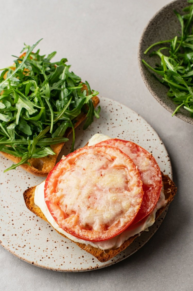 This striking, Open-Faced Tomato Parmesan Toast with Arugula recipe explodes with flavor!