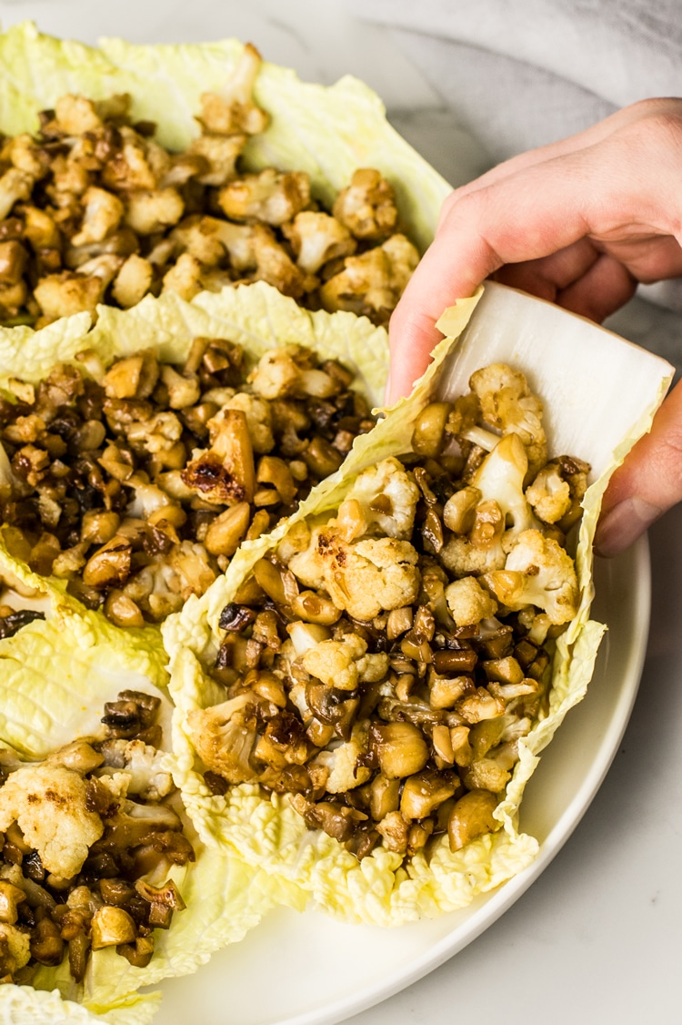 These low-calorie Skinny Cauliflower Asian Lettuce Wraps are filled with cauliflower, mushrooms, and water chestnuts.