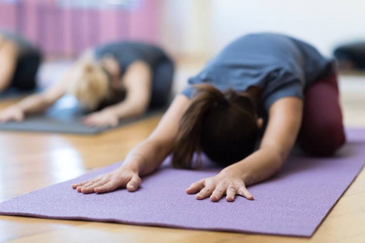 Lower your heart rate and reduce stress with a daily yoga practice.