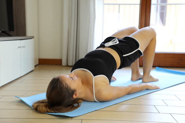 Perform the glute bridge exercise for a rounder butt!