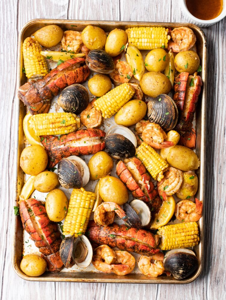 Skip the expensive seafood restaurant and make your own Maine Lobster bake at home!