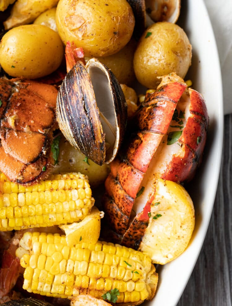 Lobster, shrimp, corn, potatoes, clams, and more create our classic Maine lobster bake.