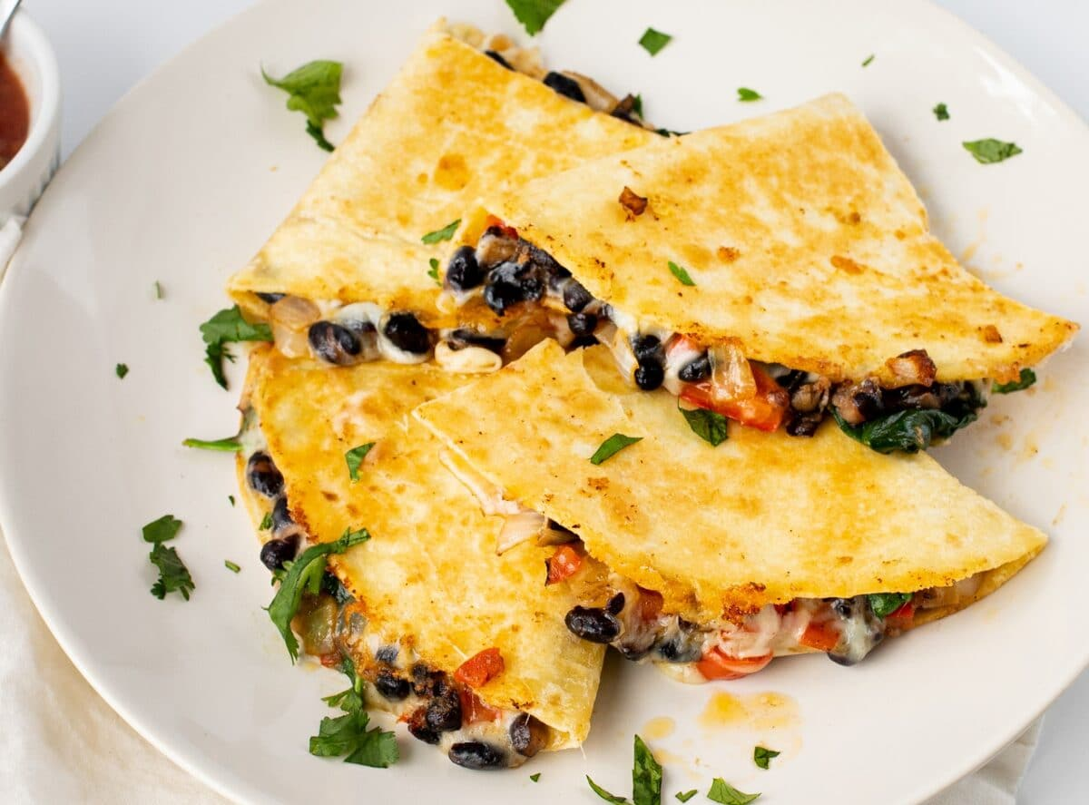 Our skinny black bean quesadillas are loaded with cheesy goodness and fresh veggies!