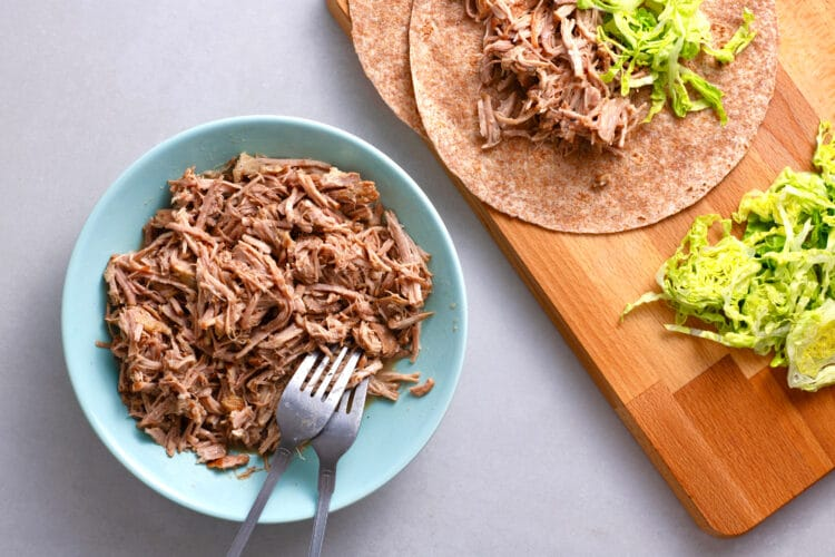 This versatile pulled pork can be serve on a bun, in a taco, on, a salad, or on its own!