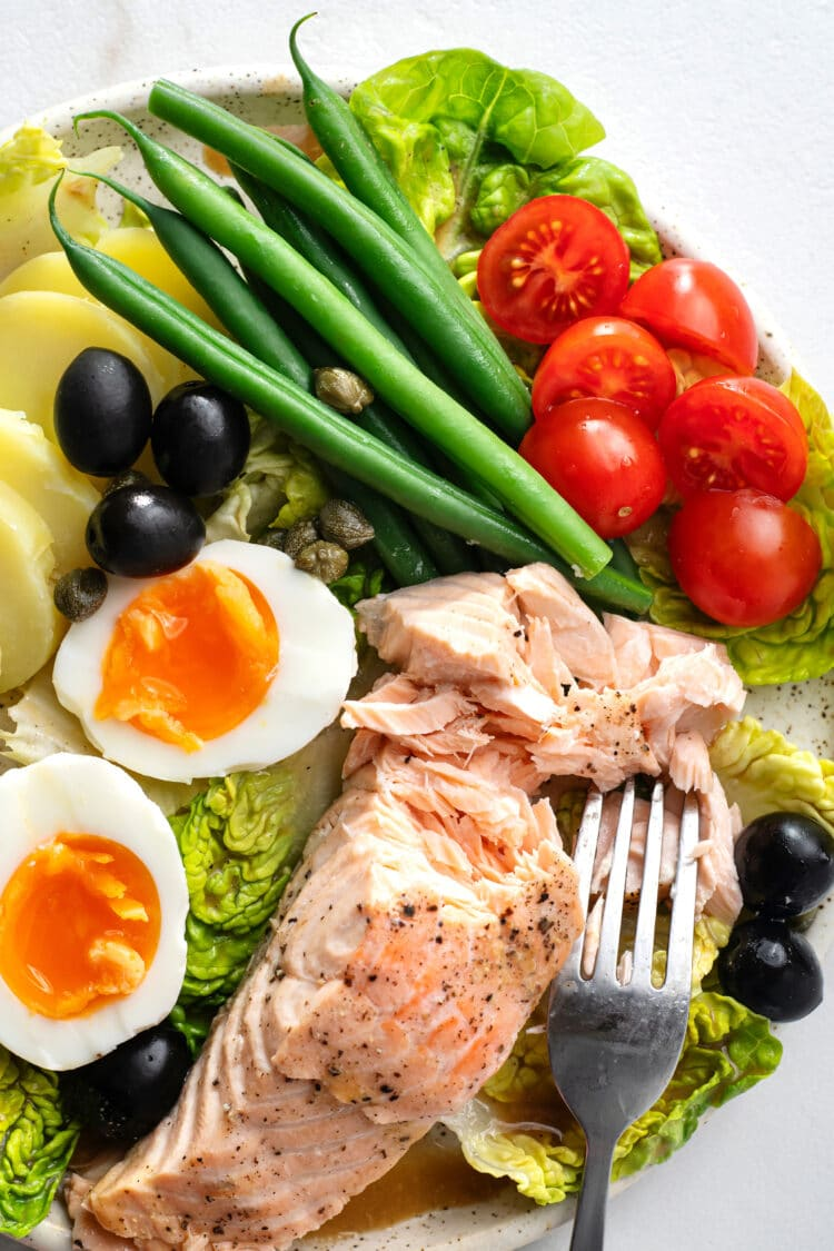 Our salad nicoise with salmon is sure to impress your dinner guests.