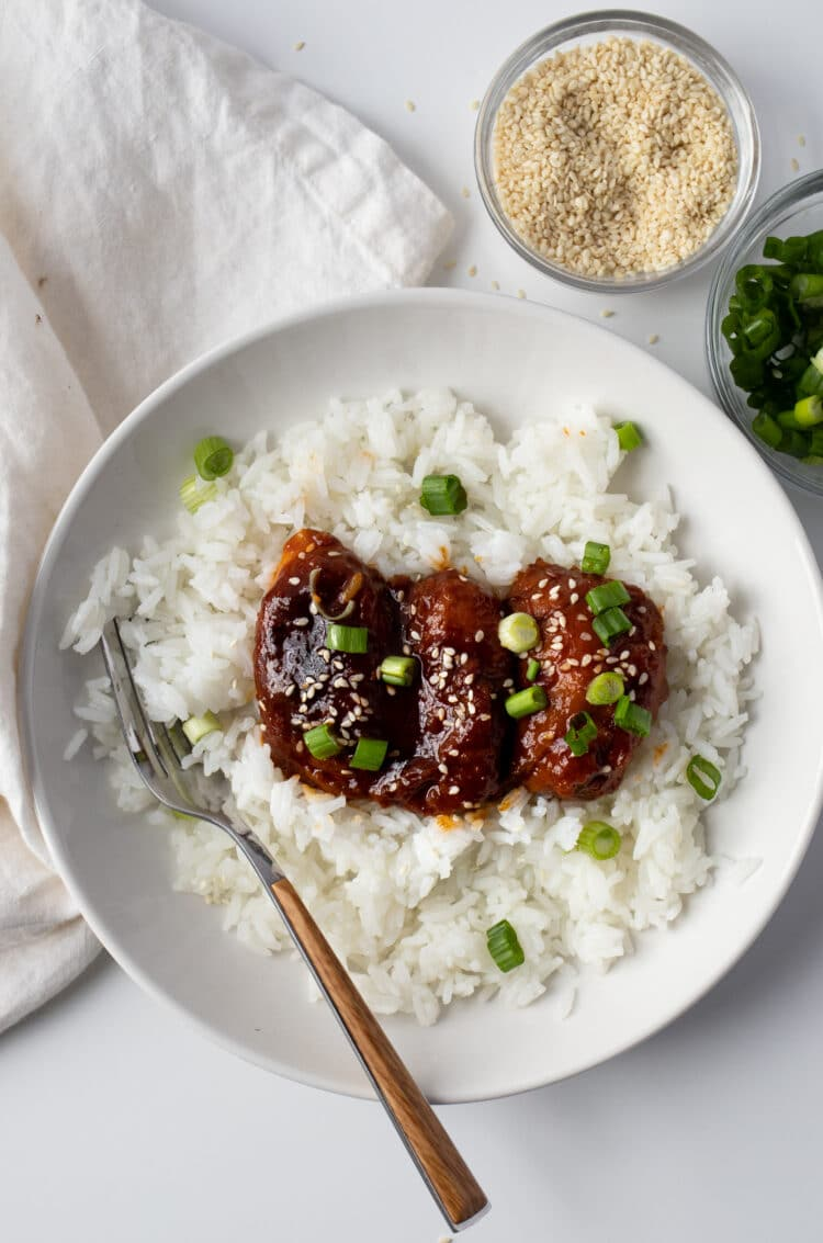 Get your fill of protein and carbs by serving these chicken thighs on a bed of white rice.