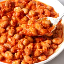 Our Slow Cooker Baked Beans are the perfect side for any family get together.